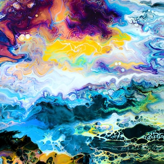 Abstract painting background made of liquid acrylic with fluid art technique with colorful bright colors.