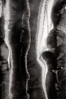 Abstract painting with epoxy resin marble streaks of blackwhitesilver