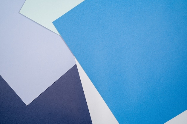 Abstract paper background with blue and cerulean colors .