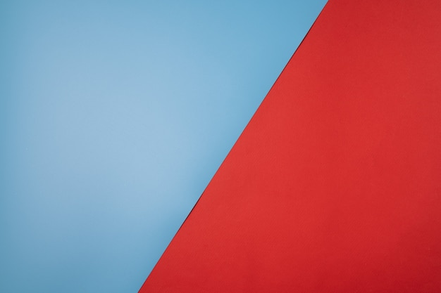 Abstract paper background with red and blue colors ,with geometric shape.