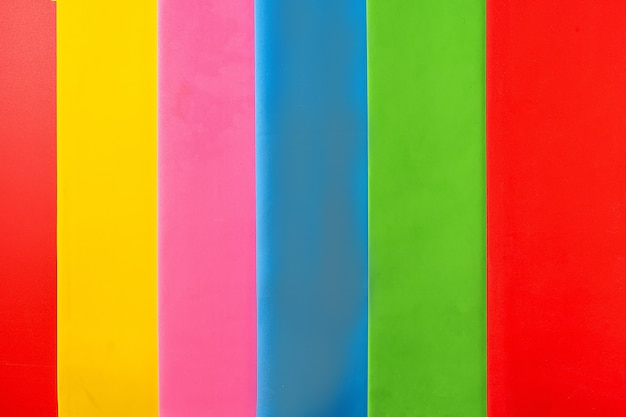 Abstract paper background with red, green, purple, pink and blue colors