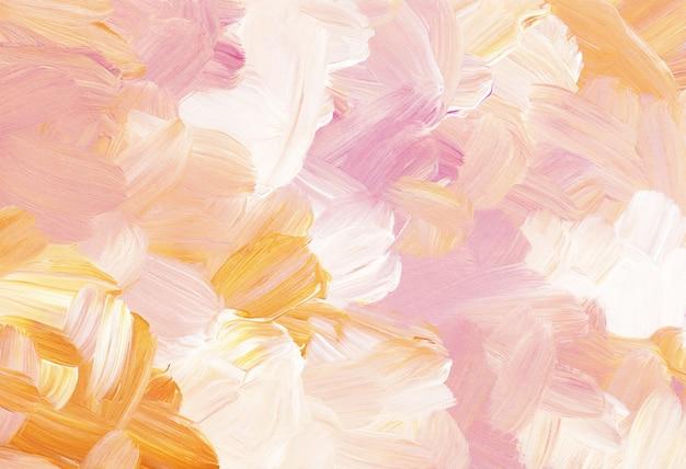 Абстрактный пастельный разноцветный фон, желтые, розовые, белые мазки кистью на бумаге