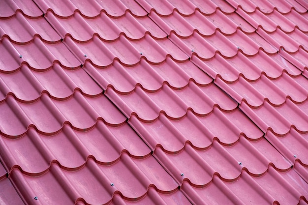 Abstract pattern of red roof tiles