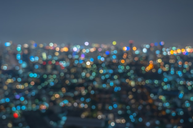 Abstract photo blurred bokeh of bangkok cityscape at twilight time, background concept