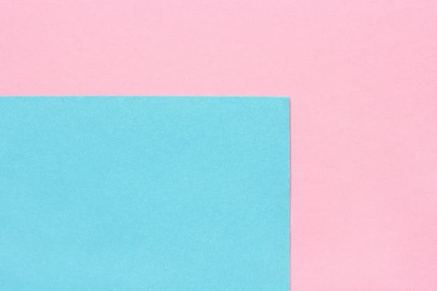 Абстрактная розовая и голубая бумажная предпосылка, текстура