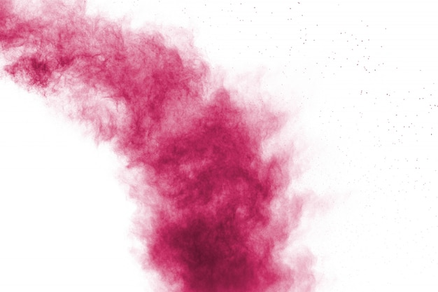 白い背景の上の抽象的なピンク粉末爆発。