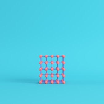 Абстрактные розовые сферы в проволочной коробке на ярко-синем фоне