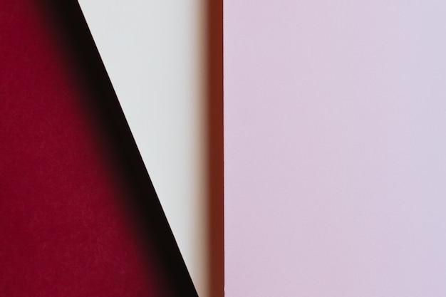 추상 분홍색 흰색 및 적포도주 색상 용지 형상 구성 배경, 미니멀한 그림자, 복사 공간. 최소한의 기하학적 모양. 화려한 배경 개념