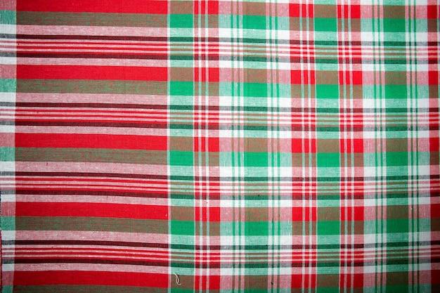 Абстрактная клетчатая текстура предпосылки набедренная повязка ткань таиланда шелк. тайский рулет из набедренной повязки на продажу на рынке в таиланде