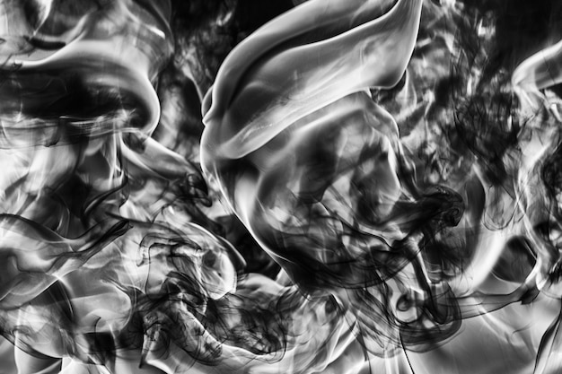Abstract plume of natural black smoke and white huge flame of strong fire motion blur from fire high...