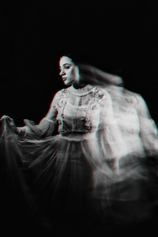 Abstract portrait of a ghost woman in a white dress