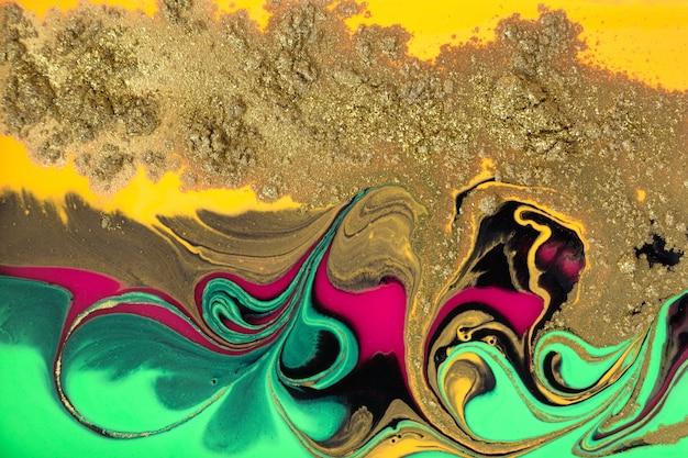 抽象的な注ぐ絵画の背景、液体アクリル絵の具