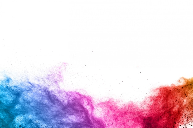 Abstract powder splatted background. colorful powder explosion on white background.