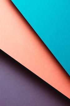 모양, 미니멀한 그림자, 복사 공간이 있는 추상 보라색, 파란색, 주황색 및 노란색 용지 형상 구성 배경. 최소한의 기하학적 모양. 화려한 배경 개념