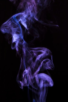 Abstract purple vaporizers fragrant steam over black backdrop