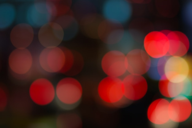 Abstract red bokeh lights on road street in city night light background