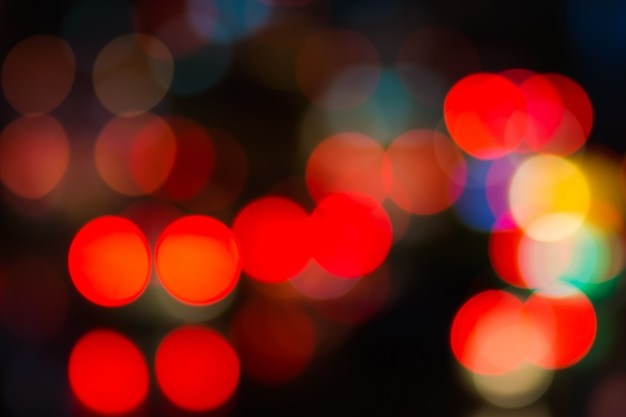 Abstract red bokeh lights on road street in city