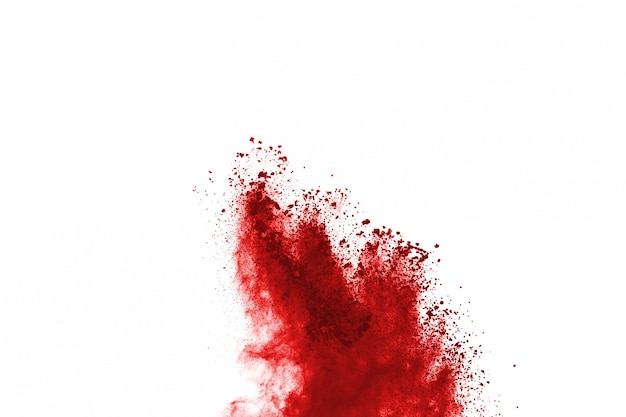 Abstract red dust explosion on white background.
