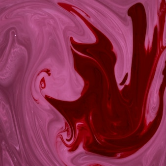 Abstract red and pink marbled textured background