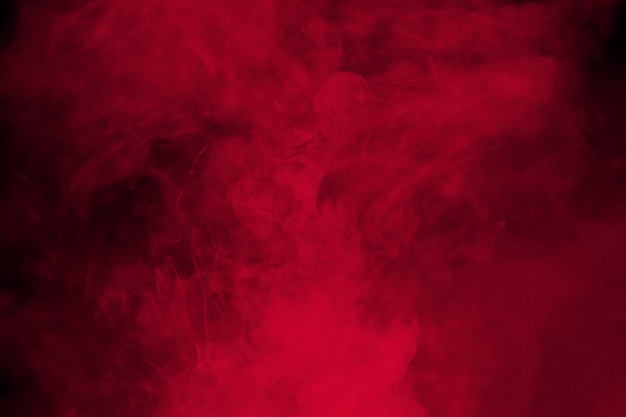 Abstract red  smoke on black background. dramatic red smoke clouds.