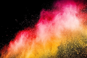 Abstract red yellow dust explosion on  black background.
