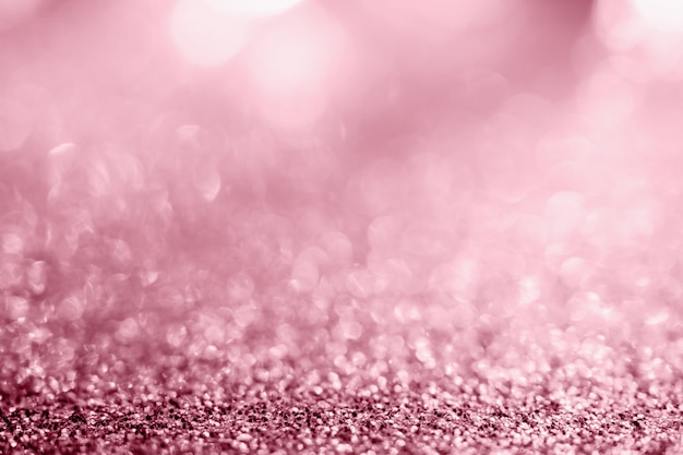 Abstract rose gold glitter sparkle texture with bokeh background