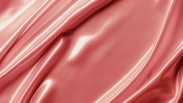 背景に抽象的なローズゴールドのサテンシルクの布、折り目波状の折り目が付いたファブリックテキスタイルドレープ。柔らかな波で、風に揺れています。