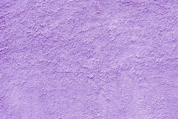 Абстрактная грубая фиолетовая текстура оштукатуренная стена здания