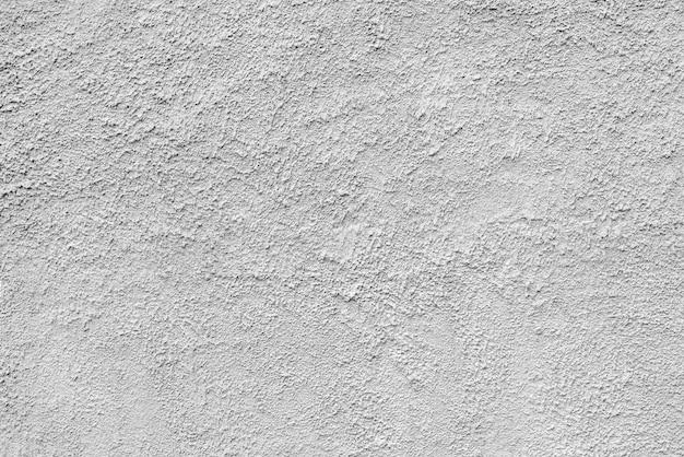抽象的な粗い白いテクスチャ漆喰の建物の壁