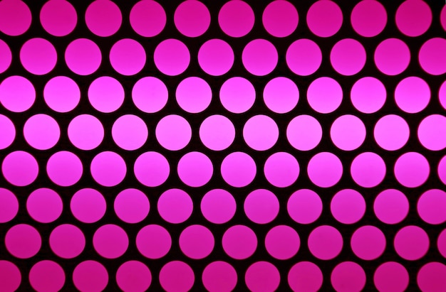 Abstract rows of gradient ultra pink circles on black background