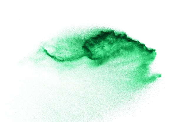 Abstract sand cloud. green sand splash against  on white background. sandy fly wave in the air.
