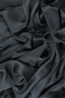 Abstract satin silky cloth,fabric textile drape with crease wavy folds.with soft waves,waving in the wind.texture of crumpled paper