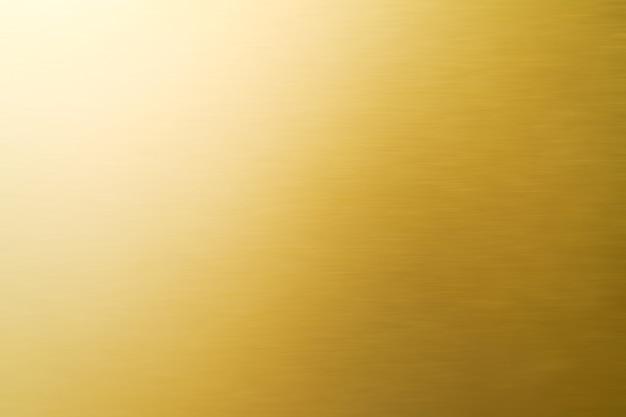 抽象的な光沢のあるゴールドのテクスチャの背景。
