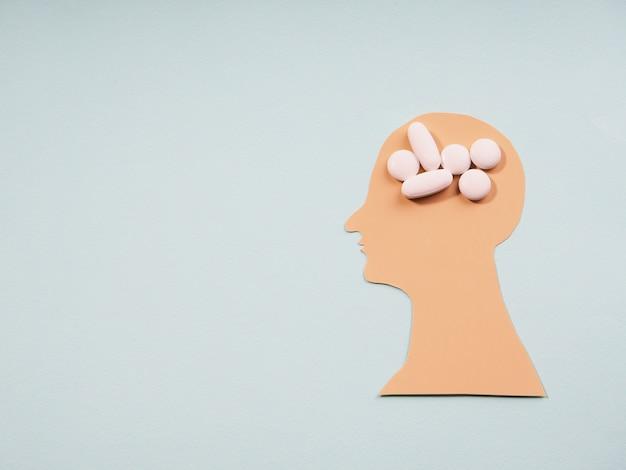 医療デザインのための抽象的なシルエットの頭の健康。メンタルヘルス、脳障害の概念。家族の世話。