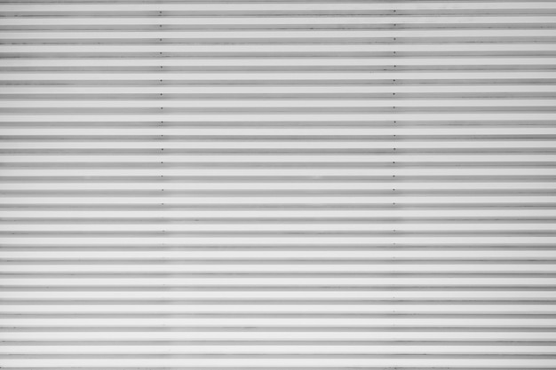 Abstract silver background with horizontal lines, lit with a soft light.