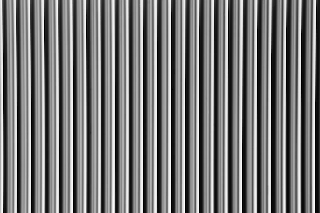 Abstract silver background with vertical lines, lit with a soft light.