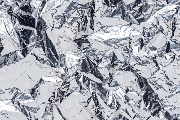 Abstract silver crumpled foil background.