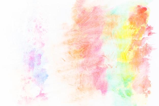 赤と黄色の染料の抽象的な汚れ