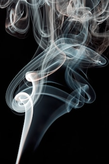 Abstract smoke background a over black background