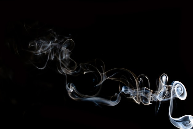 Abstract smoke line movement with white light effect on black background