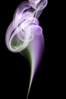 Abstract smoke shapes over a black background