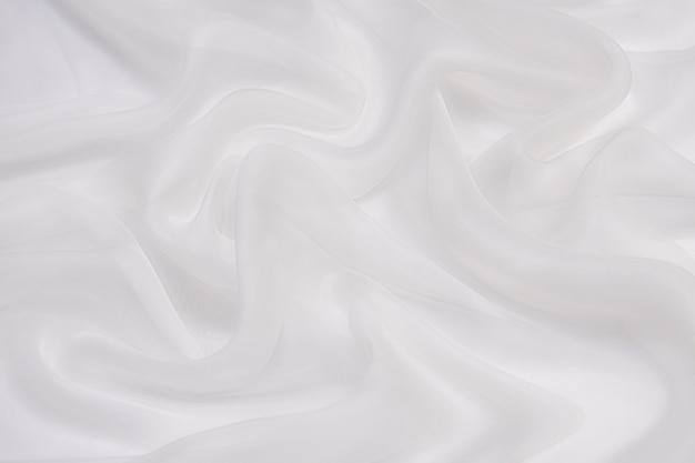 Абстрактная мягкая шифоновая ткань текстуры фона. мягкий белый шифон с изгибом и волнистым узором.