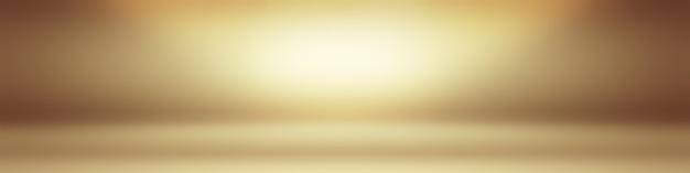 Абстрактное твердое тело сияющего желтого градиента студии стены комнаты фона