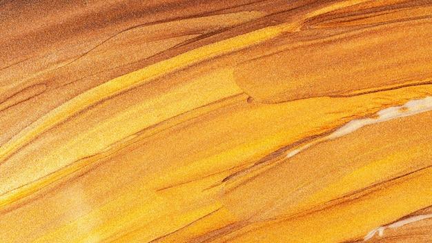 Абстрактная сверкающая металлическая текстура. бронзово-оранжевый фон с блестящими мазками. креативные мазки золотой искрящейся краски. праздничный фон