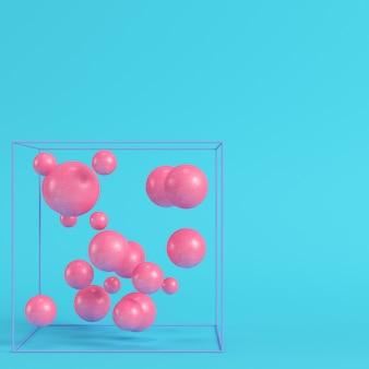 Абстрактные сферы в проволочной коробке на ярко-синем фоне в пастельных тонах