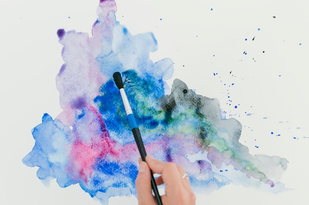 Abstract splashes of colorful watercolor and blue ink