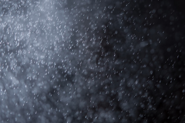 Abstract splashes of water or snow on a dark background