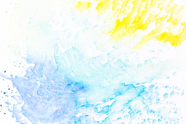 Abstract splashes of yellow and turquoise paint