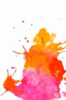 オレンジとフクシアの塗料の抽象的な汚れ