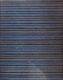 Abstract steel wall vertical stripes copy space